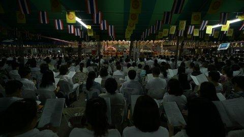 Bangkok, Thailand - 12 31 2018: Thai Buddhists pray at a New Year ceremony.