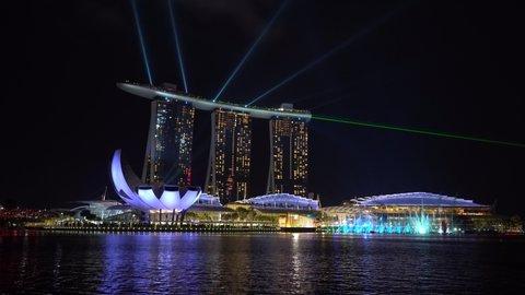 SINGAPORE CITY, SINGAPORE - MARCH 29, 2019: Marina Bay Sands is an integrated resort fronting Marina Bay at night view, establishing shot