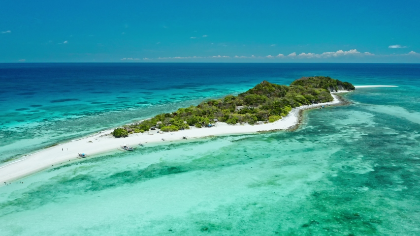 Truly amazing tropical island in the middle of the ocean. Aerial view of an island with white sand beaches and beautiful lagoons | Shutterstock HD Video #1030983524