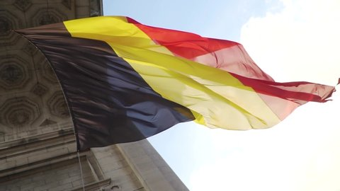 Belgium flag against tricolour stripes waving on wind from Arcade du Cinquantenaire 1920X1080 HD footage (1080p 100fps FullHD video)