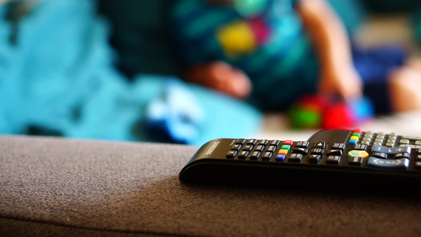 Samsung Television remote laying on a sofa in a living room on circa June 2019 in Poznan, Poland.  | Shutterstock HD Video #1031009834