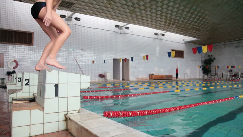 Young Boy Swimmer Ready to Race in Pool