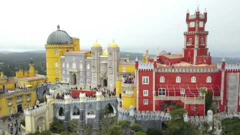 The Pena Palace, a Romanticist castle in the municipality of Sintra, Portugal, Lisbon district, Grande Lisboa, aerial view, shot from drone. Camera moves