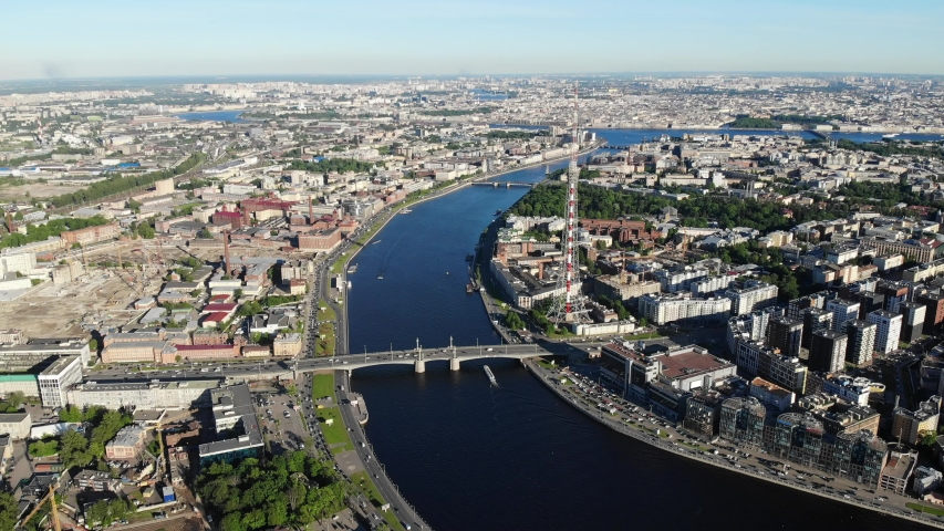 Beautiful super-wide angle aerial summer view of Saint-Petersburg, Russia, with Aptekarsky Island, Neva delta river, Saint Petersburg TV Tower and Kantemirovsky Bridge, shot from drone | Shutterstock HD Video #1031084354