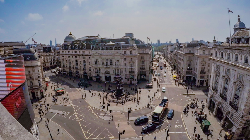 London, London / United Kingdom (UK) - 11 04 2018: Time-lapse of traffic and tourists at Piccadilly Circus