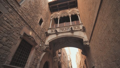 Bridge between buildings in Barri Gotic quarter of Barcelona, Spain. Old streets of Barrio Gotico in Barcelona, Catalonia. It is centre of old city of Barcelona. Center of touristic life.