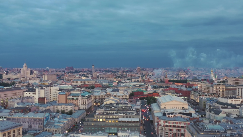 Aerial photography in the center of Moscow. Drone flies in the direction of Red Square. And over the red square there is dissipated the smoke from the salute in honor of the holiday of the day of Russ | Shutterstock HD Video #1031273384