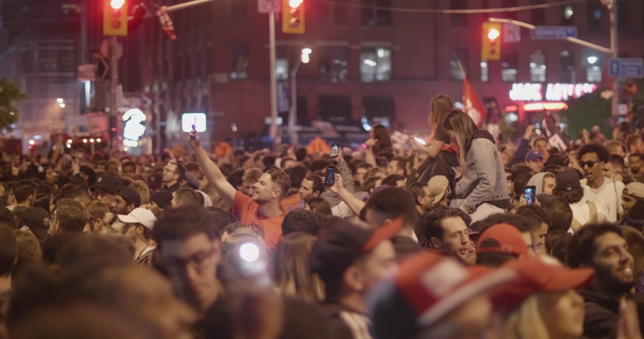 TORONTO - JUNE 13TH: Toronto Raptors fans celebrate their team's historic win in the NBA finals as seen on June 13th, 2019 in Toronto, Canada. | Shutterstock HD Video #1031386664