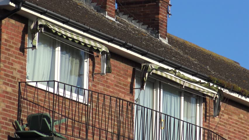 Close Up Of Window Awnings Being Blown In The Wind On A Residential House Sunny Day Stock Footage Video 10314104