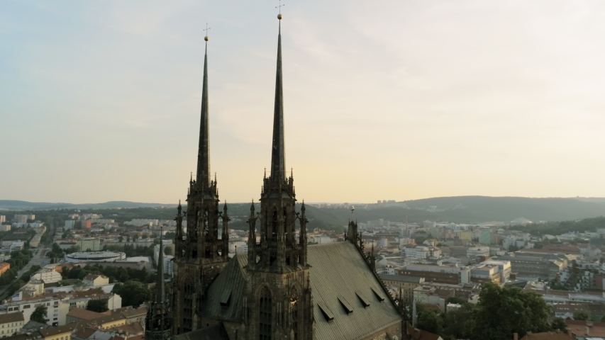 Aerial View of Medieval Gothic basilica Church on Petrov Hill and Old Town at Sunset. Brno, Czech Republic, Cathedral Of St. Peter And St. Paul. 4K Panning Drone Shot | Shutterstock HD Video #1031471414