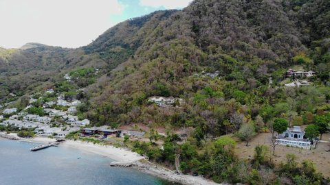 Huge pitons drone view at Saint Lucia sugar beach St Lucia mountains