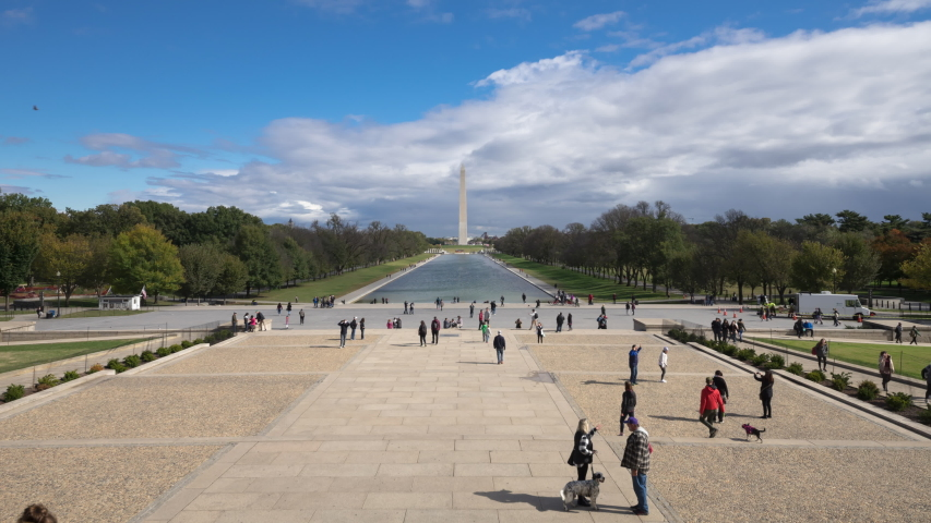 Time Lapse of the Washington Monument, Reflecting Pool and National Mall from the steps of the Lincoln Memorial with clouds and people moving