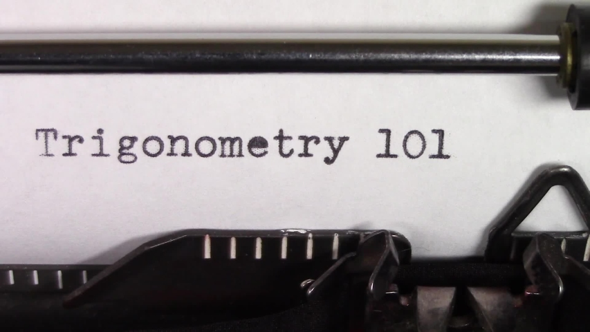 """A close up video of the words """"Trigonometry 101 """" being typed on white paper in an old manual typewriter. Shot in macro.   Shutterstock HD Video #1031830454"""