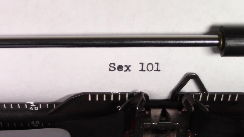 """A close up video of the words """"Sex 101 """" being typed on white paper in an old manual typewriter. Shot in macro.   Shutterstock HD Video #1031830484"""