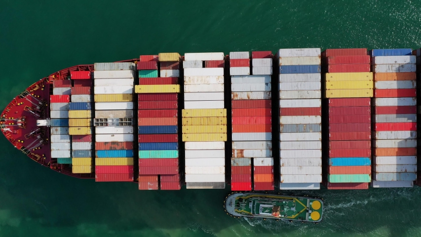 Aerial view on the top of the cargo ship carrying out export and import business Logistics and transportation | Shutterstock HD Video #1031838644