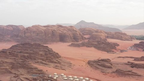 Drone shots in Wadi Rum also known as The Valley of the Moon , it is a valley cut into the sandstone and granite rock in southern Jordan 60 km (37 mi) to the east of Aqaba .