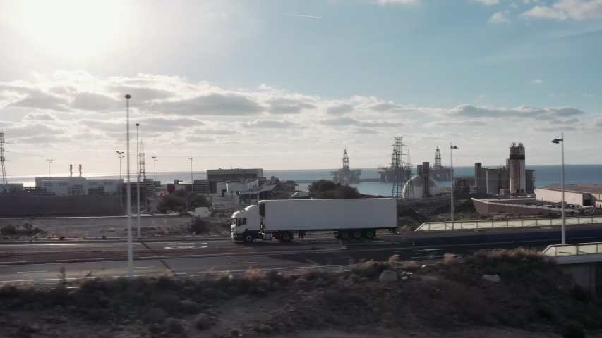 White Truck Drives Through Industrial Warehouse Area in Early Hours of the Morning . Follow-up Shot of a Semi-Truck with Cargo Trailer Moving on a Highway. | Shutterstock HD Video #1031875094