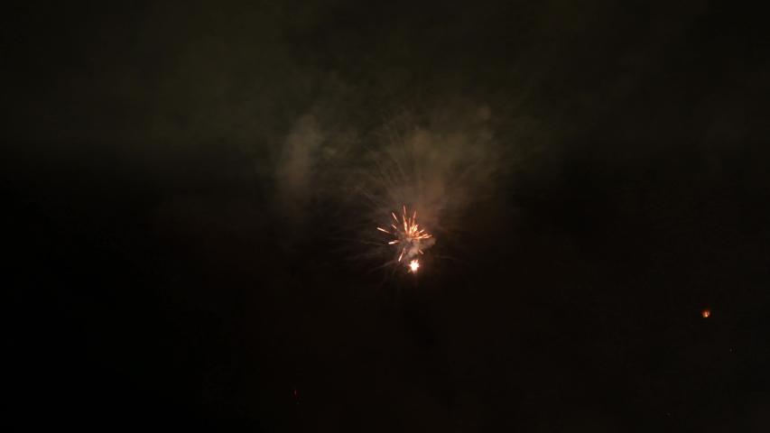 Colorful castle of fireworks in a celebration - loop   Shutterstock HD Video #1032037124