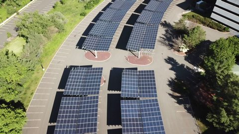 Drone over solar large solar panels next to building