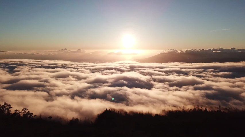 Drone flight above the clouds at Mount Haleakala in Maui, Hawaii | Shutterstock HD Video #1032718034