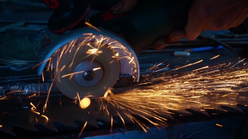 Professional blacksmith sawing metal with bare hands circular saw at forge. Blacksmithing concept. Slow motion - 60 fps. | Shutterstock HD Video #1032810314