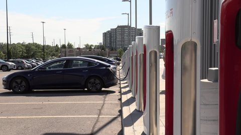 Toronto, ontario, canada july 2019 tesla electric car charging station with  cars recharging their batteries