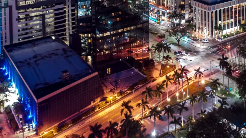 Aerial view of Miami city hyperlapse 4k drone panorama view flight over Miami at night.