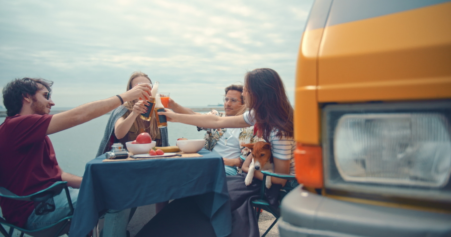 Multiracial happy friends enjoying camping vacation by camper van chilling near the sea making cheers and having fun, Adventure Summertime Holidays Concept, Slow Motion, Cinematic Shot | Shutterstock HD Video #1032989324