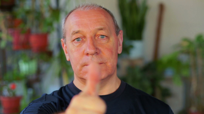 A man does exercises with his eyes looking at his finger and moving it away. | Shutterstock HD Video #1033084184