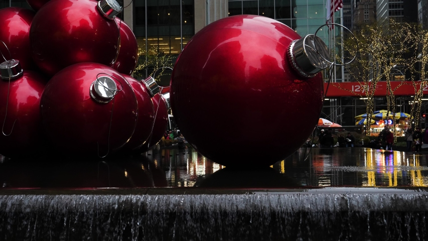 New York City, New York / United States - 12 12 2018: big red Christmas holiday ornaments in new york Rockefeller center Radio City Music Hall