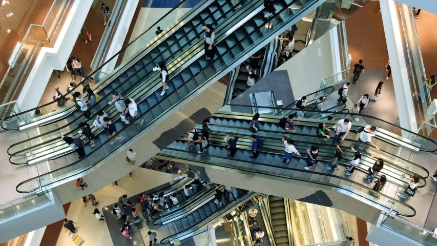 Time lapse of crowd of people in shopping mall. Escalators in modern shopping mall. | Shutterstock HD Video #1033176344