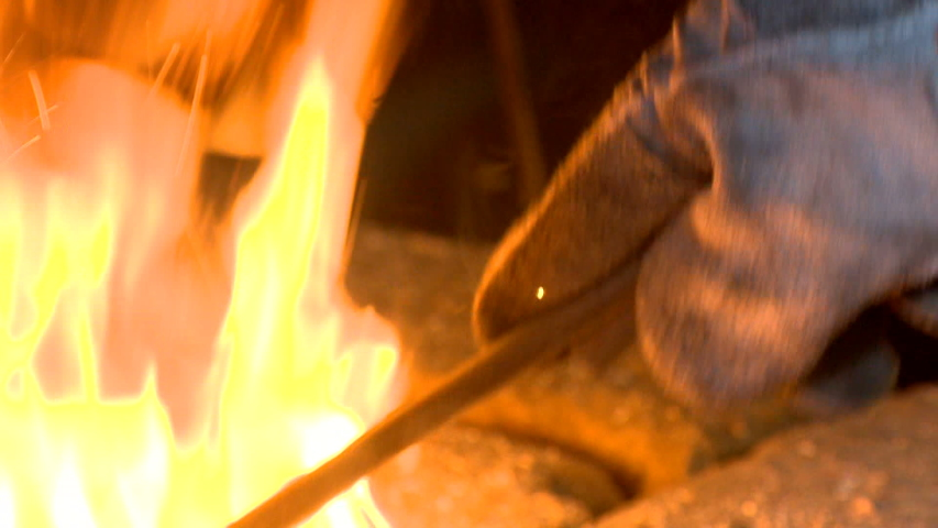 The art of the master in the smith of a forging metal with the help of the hammer of fire and the craft of tradition | Shutterstock HD Video #1033244834