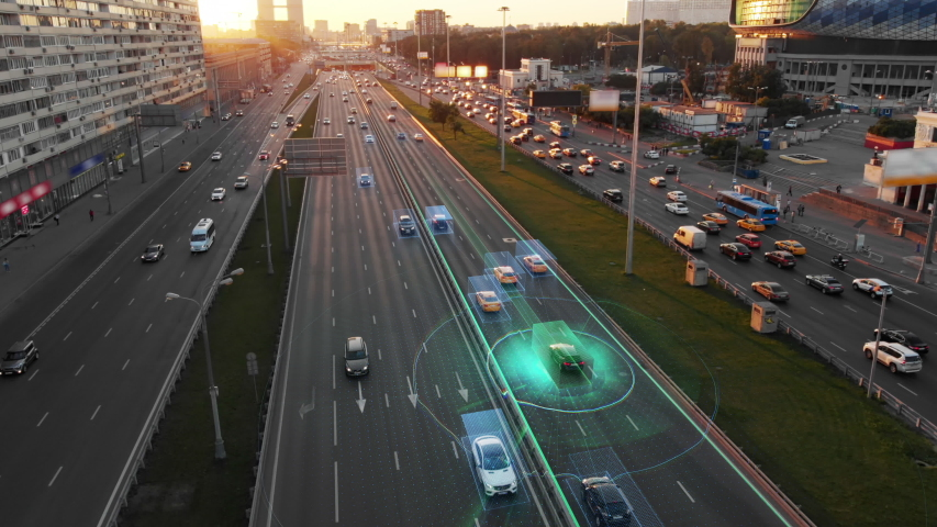 Beautiful aerial view to autonomous cars self-driving on the highway in Moscow. Picturesque aerial panorama of the road traffic in a big city on the sunset. | Shutterstock HD Video #1033280714