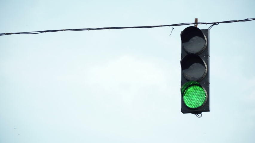 City traffic light hanging on the wire   Shutterstock HD Video #1033419284