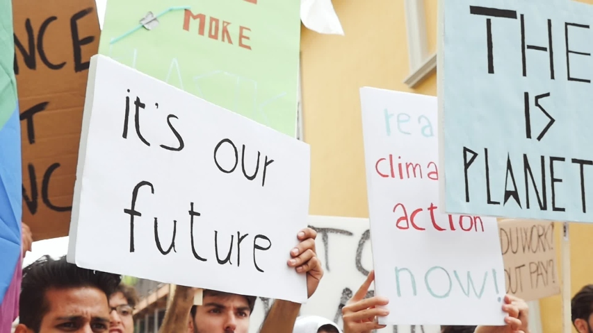 Public demonstration on the street against global warming and pollution. Group of multiethnic people making protest about climate change and plastic problems in the oceans | Shutterstock HD Video #1033661714