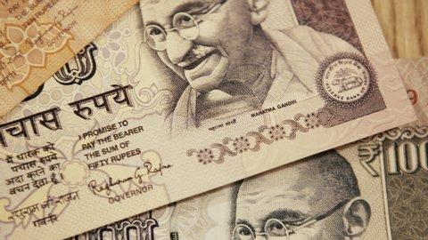 warsaw, Poland - 07 08 2019: Pedestal down: close up of 10/50/100 Indian rupee banknotes with Mahatma Gandhi