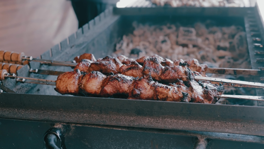 Close-Up Meat is Roasted on Coals in a Street Restaurant | Shutterstock HD Video #1033960304