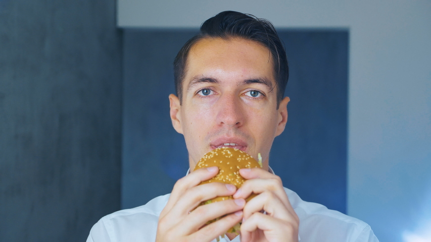 Timelapse of man eating a hamburger. Fast food. Cheeseburger, hamburger, sandwich. | Shutterstock HD Video #1034025374