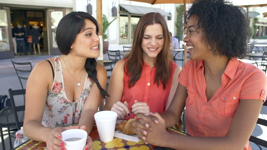 Group of three female friends meeting at caf\x8E and then take selfie on mobile phone in slow motion.Shot on Sony FS700 at frame rate of 50fps | Shutterstock HD Video #10341464