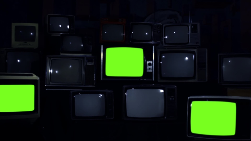 """Retro Televisions Turning On Green Screen. Blue Dark Tone. Zoom In. You can replace green screen with the footage or picture you want with """"Keying"""" effect in AE (check out tutorials on Internet). 