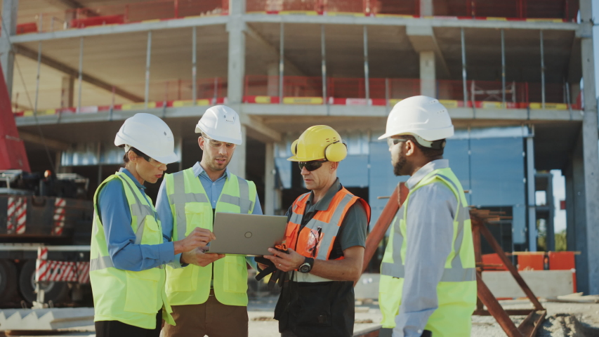 Diverse Team of Specialists Use Laptop Computer on Construction Site. Real Estate Building Project with Civil Engineer, Architectural Investor, Businesswoman and Worker Discussing Plan Details | Shutterstock HD Video #1034288114
