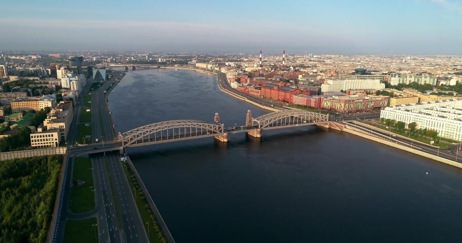 Bolsheokhtinsky bridge across Neva River in summer day, also known as Peter the Great Bridge, Saint-Petersburg, Russia | Shutterstock HD Video #1034383214