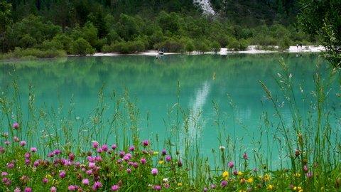 The beautiful turquoise lake of Landro near Dobbiaco (Bolzano) in the Sexten Dolomites. South Tyrol, Italy.