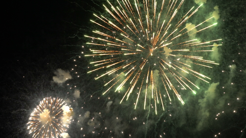 Colorful fireworks on the beach for abstract , anniversary, celebration , 4th independence day and new year background or wallpaper | Shutterstock HD Video #1034503754