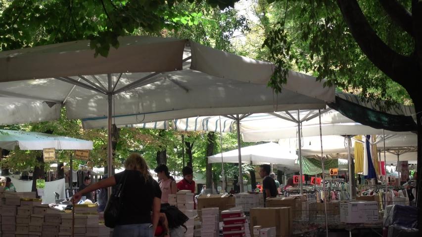 Reggio Emilia / Italy - 07/15/2019: The market of Piazza Fontanesi in Reggio Emilia | Shutterstock HD Video #1034538854