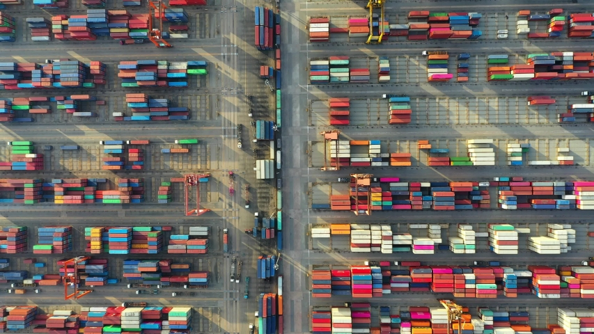 Aerial view. Container ship in pier with crane bridge carries out export and import business in the open sea. Logistics and transportation   | Shutterstock HD Video #1034547494
