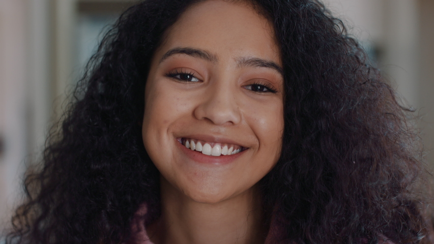 portrait beautiful teenage girl in kitchen at home smiling happy enjoying carefree lifestyle #1034673554