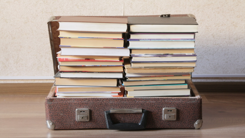 Timelapse old suitcase filled with books | Shutterstock HD Video #1034780234