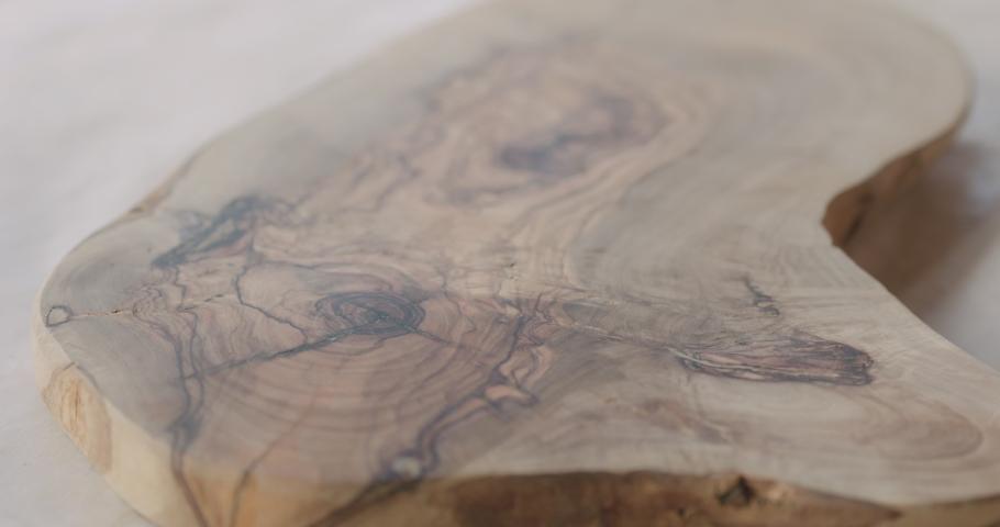 Slow motion woodworker applying oil finish to olive wood board | Shutterstock HD Video #1034935904