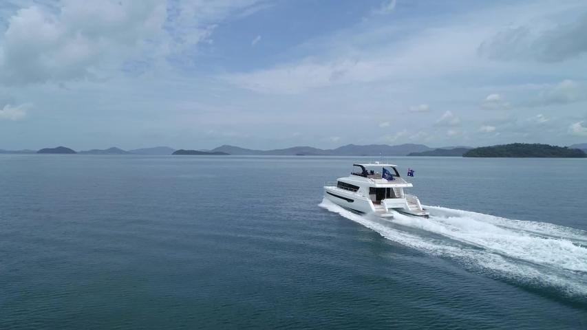 Luxury catamaran multi hull power boat at speed out in open water   Shutterstock HD Video #1035140084